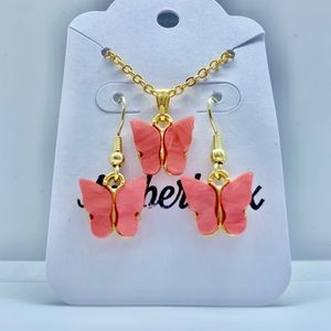 Pink butterfly necklace and earring set